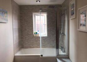 bathroom with a bath shower