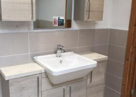 sink with cabinets and mirror